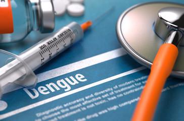 Dengue - Printed Diagnosis on Blue Background and Medical Composition - Stethoscope, Pills and Syringe. Medical Concept. Blurred Image. 3D Render.