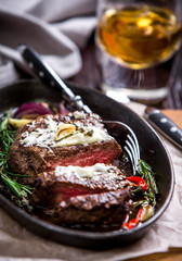 Healthy lean grilled medium-rare steak and vegetables