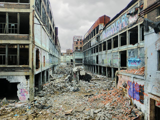 Detroit abandoned factory warehouse crumbling into apocalypse - landscape color photo