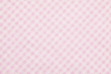Pink textile, napkin, tablecloth on blue wooden kitchen table. View from above, top with copy space. Traditional pattern and color.