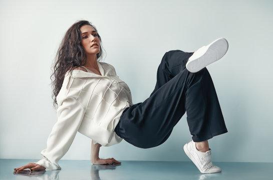 Fashion beautiful woman posing on the floor