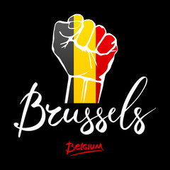 Fist of Belgium flag painted, multi purpose concept - isolated on white background. lettering hand-written Belgium, Brussele.