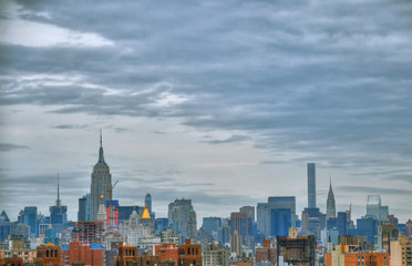 Artistic colorful HDR image of the skyline of Midtown Manhattan, New York City during sunset on a cloudy day