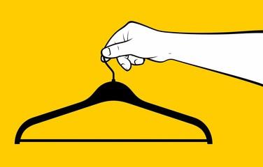 Hand holding hanger