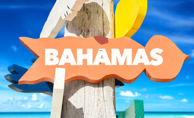 Bahamas signpost with beach background
