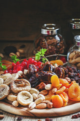 Mix dried fruits and nuts, healthy diet, eating lean, old wooden
