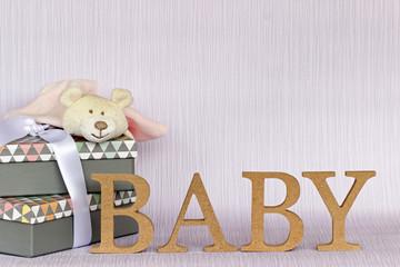 Fototapete - Schriftzug Baby mit Geschenken