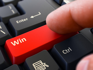 Win Button. Male Finger Clicks on Red Button on Black Keyboard. Closeup View. Blurred Background. 3D Render.