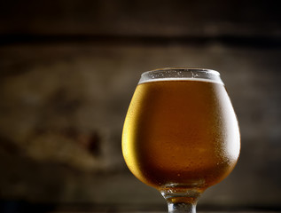 beer in a glass on a wooden background