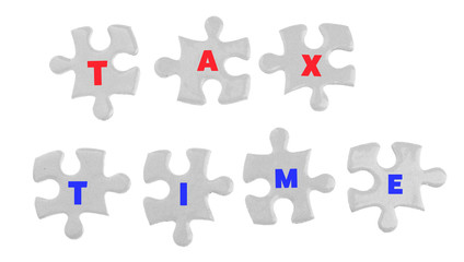 Tax Concept. White jigsaw puzzle with pieces isolated on white