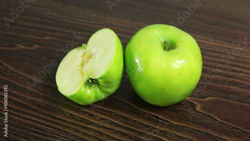 """Green apple on the table rotates"""" Stock footage and royalty-free ..."""