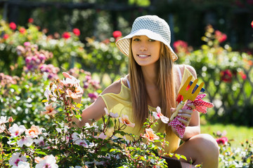 Smiling woman in yard gardening