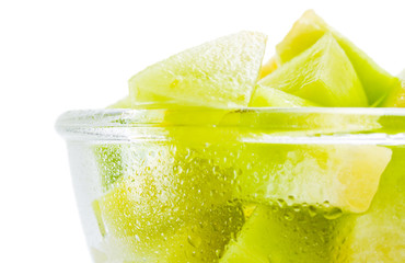 Melon honeydew portion. Rape fresh melon honeydew pieces in a glass  bowl close up  isolated on white background.