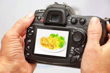 Photo of isolated food on camera display during session. Making stock photography.
