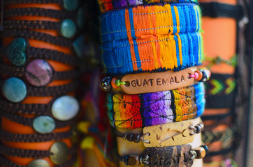 Hand-made wristband with sign Guatemala on it