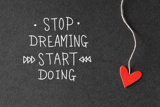 Stop Dreaming Start Doing message with paper hearts
