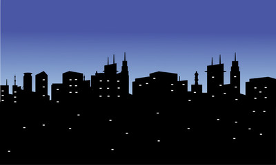silhouette of the city with twinkling lights