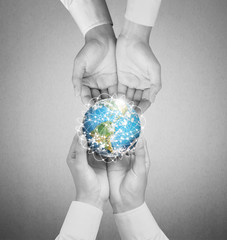hand holding globe Elements of this image furnished by NASA