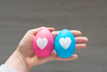 Easter eggs with hearts in a hand at the person.