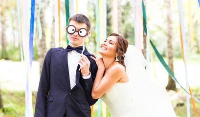 April Fools' Day. Wedding couple have fun with mask.