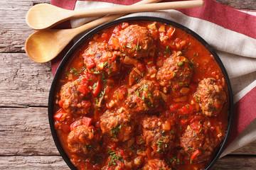 Tasty food: Meatballs albondigas with tomato sauce close-up. horizontal top view