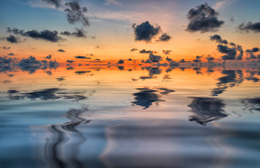 Background of the sky with clouds and a colorful reflection of t