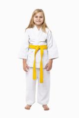 Full length portrait of a karate girl in kimono