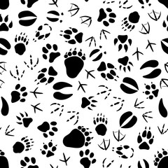 Black tracks of animals and birds seamless pattern over white background. Nature or wildlife theme or scrapbook page backdrop design