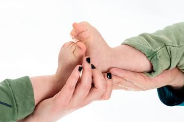Baby Twins Feet in parents hands