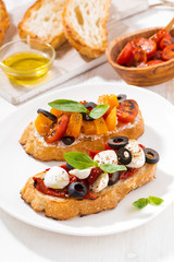 bruschettas with tomatoes and mozzarella, top view vertical