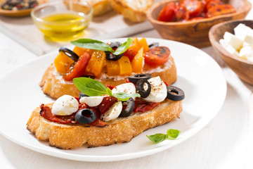 bruschettas with tomatoes and mozzarella