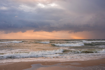 Landscape stormy sea at sunset