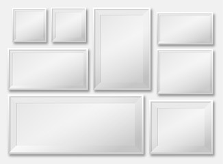 blank picture frame template set isolated on wall