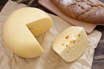 Cheese wheel on wood. Organic food