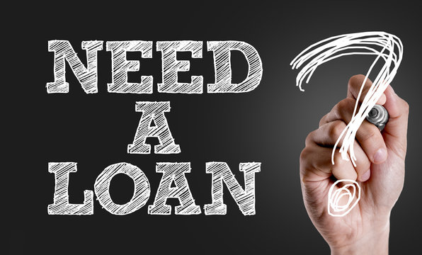 Hand writing the text: Need a Loan?