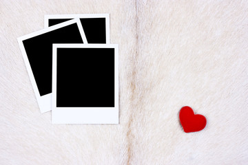 Photo frames on goat fur with red heart