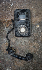 Old vintage phone off the hook on grunge background