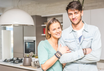Happy couple portrait in the kitchen