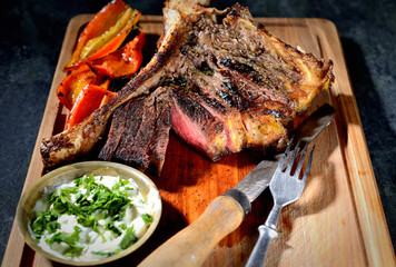 grilled steak on the wooden background