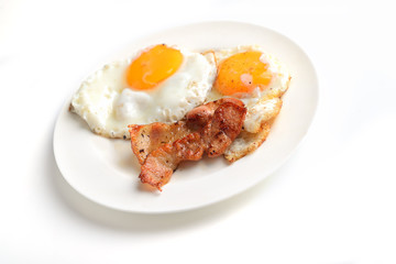 bacon and eggs on a white background