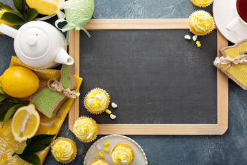 Easter background with lemon cupcakes