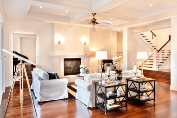 Beautiful drawing room with glossy wooden floor and telescope at