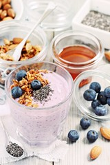 Overnight chia seeds and blueberry yogurt with homemade granola.Healthy eating concept.Selective focus