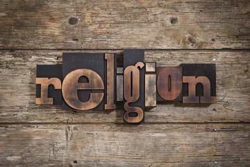 religion written with letterpress type