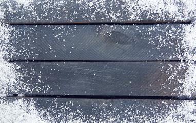 Snowy grey wooden background