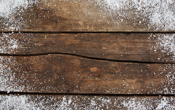 Snowy brown wooden background