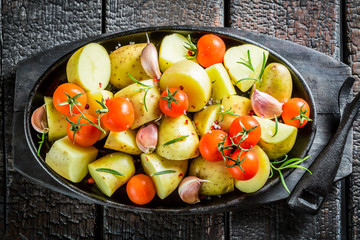 Potato with rosemary and garlic on barbecue dish