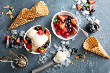 Vanilla ice cream scoops with berries