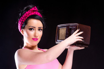 Pin-up Girl Holding Vintage Radio