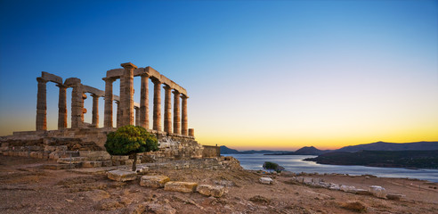 Greece. Cape Sounion - Ruins of an ancient Greek temple of Poseidon after sunset Wall mural